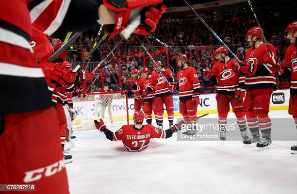 Andrei Svechnikov of the Carolina Hurricanes celebrates during the team's storm surge after their victory over the Philadelphia Flyers following an...