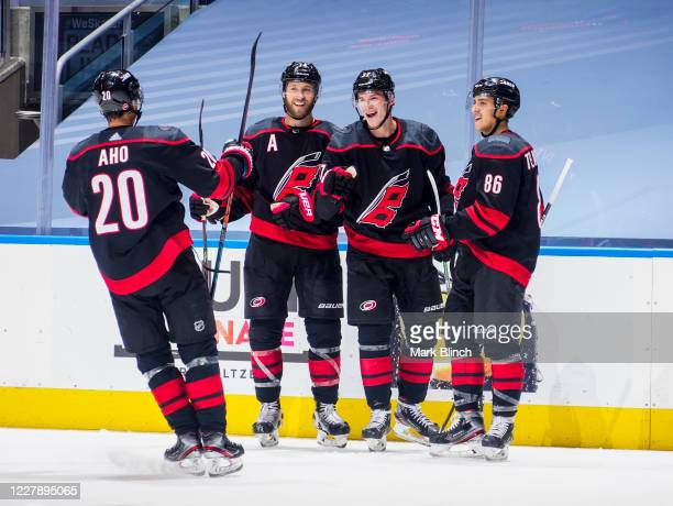 Andrei Svechnikov of the Carolina Hurricanes celebrates his third goal for eh game against the New York Rangers with team-mates Sebastian Aho, Jaccob...