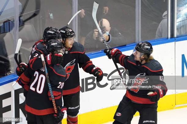 Andrei Svechnikov of the Carolina Hurricanes celebrates with Sebastian Aho, Teuvo Teravainen and Sami Vatanen after scoring a goal against the New...