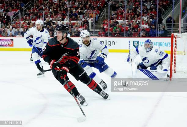 Andrei Svechnikov of the Carolina Hurricanes controls the puck along the redline in Game Two of the Second Round against the Tampa Bay Lightning of...