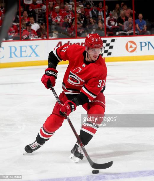 Andrei Svechnikov of the Carolina Hurricanes controls the puck on the ice during an NHL game against the New York Islanders on October 4 2018 at PNC...