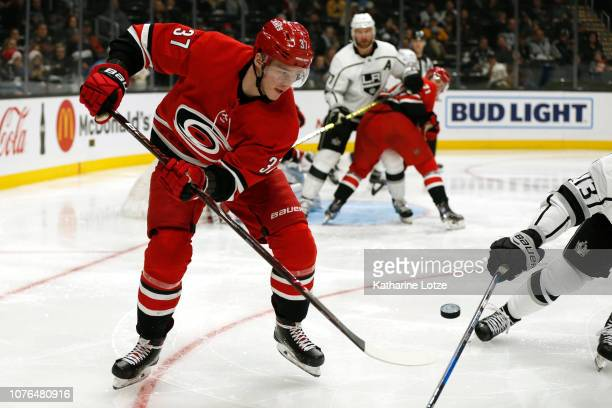 Andrei Svechnikov of the Carolina Hurricanes fights for control of the puck during the third period at Staples Center on December 02 2018 in Los...