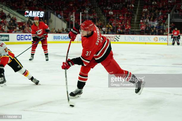 Andrei Svechnikov of the Carolina Hurricanes fires a shot on net and scores the game winner during an NHL game against the Calgary Flames on October...