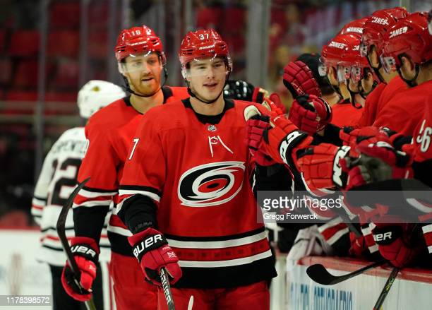 Andrei Svechnikov of the Carolina Hurricanes is congratulated by teammates after scoring a goal during an NHL game against the Chicago Blackhawks on...