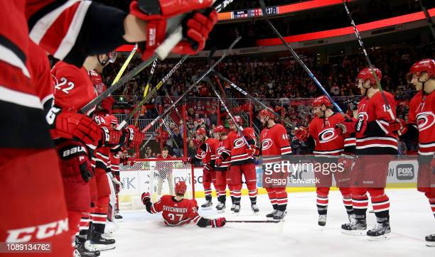 Andrei Svechnikov of the Carolina Hurricanes participates in the Storm Surge with teammates after a victory over the Philadelphia Flyers during an...