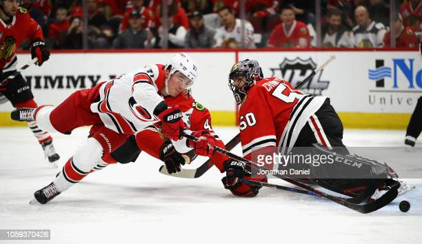 Andrei Svechnikov of the Carolina Hurricanes pushes the puck past Corey Crawford of the Chicago Blackhawks to score a first period goal at the United...