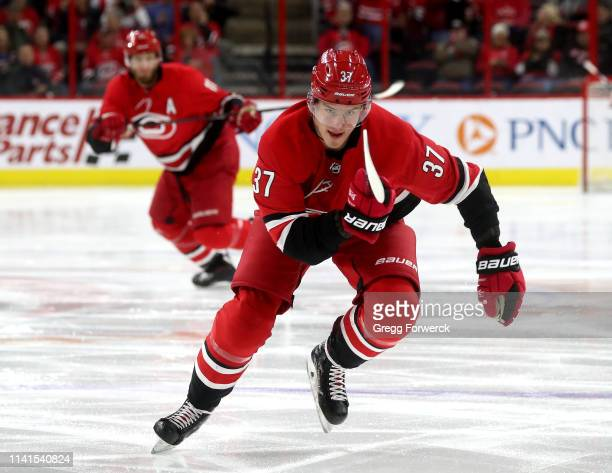 Andrei Svechnikov of the Carolina Hurricanes saktes for position on the ice during an NHL game against the Minnesota Wild on March 23 2019 at PNC...