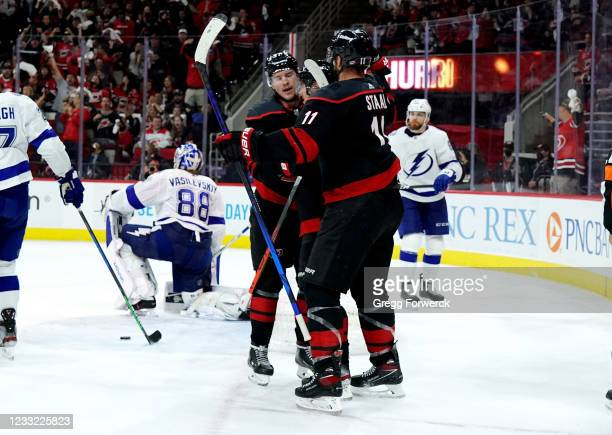 Andrei Svechnikov of the Carolina Hurricanes scores a goal and celebrates with teammates in Game Two of the Second Round of the 2021 Stanley Cup...
