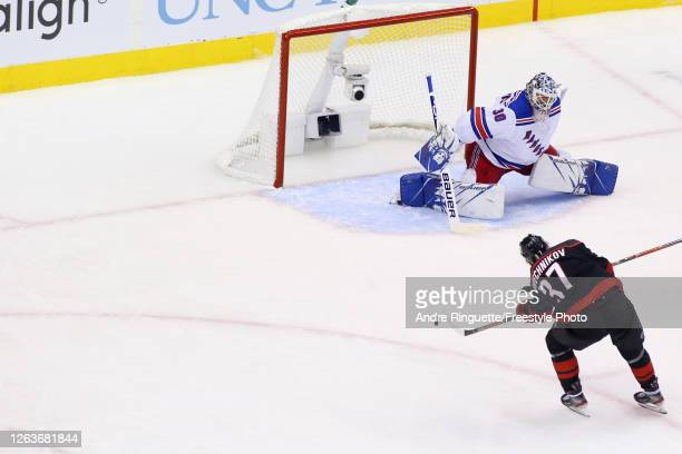 Andrei Svechnikov of the Carolina Hurricanes scores a hat-trick goal against the New York Rangers in Game Two of the Eastern Conference Qualification...