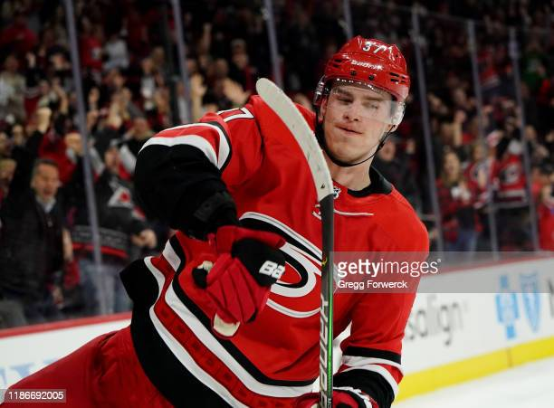 Andrei Svechnikov of the Carolina Hurricanes scores a shootout goal and celebrates during an NHL game against the San Jose Sharks on December 5, 2019...