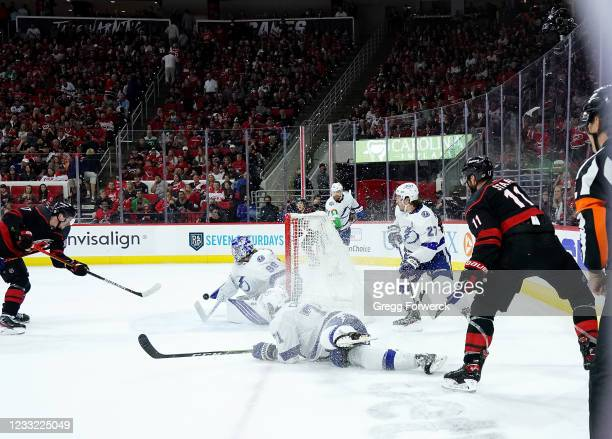 Andrei Svechnikov of the Carolina Hurricanes scores a third period goal after a pass from teammate Jordan Staal in Game Two of the Second Round of...