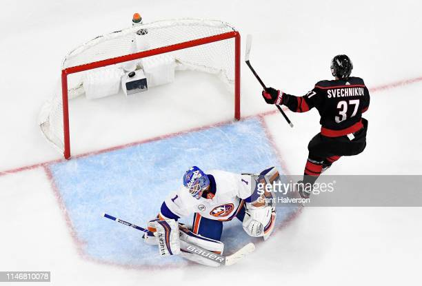 Andrei Svechnikov of the Carolina Hurricanes scores against Thomas Greiss of the New York Islanders in the third period of Game Four of the Eastern...