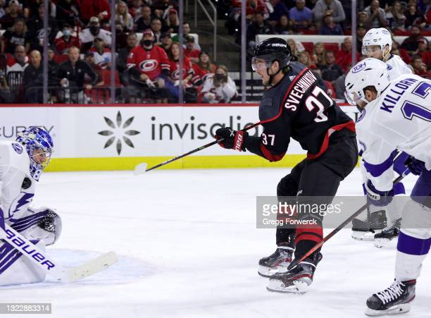 Andrei Svechnikov of the Carolina Hurricanes shoots the puck as Andrei Vasilevskiy makes a save in Game Five of the Second Round of the 2021 Stanley...