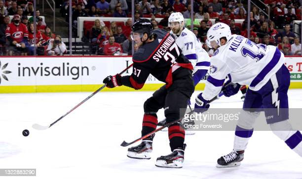 Andrei Svechnikov of the Carolina Hurricanes shoots the puck in Game Five of the Second Round of the 2021 Stanley Cup Playoffs against the Tampa Bay...