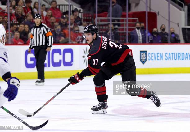Andrei Svechnikov of the Carolina Hurricanes skate with the puck in Game Five of the Second Round of the 2021 Stanley Cup Playoffs against the Tampa...