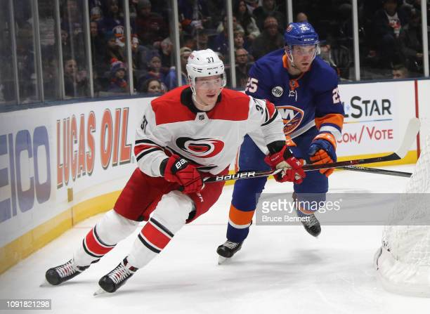 Andrei Svechnikov of the Carolina Hurricanes skates against the New York Islanders at NYCB Live at the Nassau Veterans Memorial Coliseum on January...