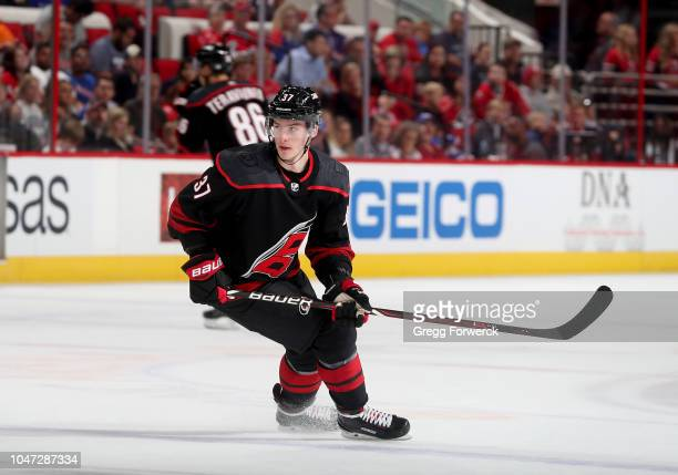 Andrei Svechnikov of the Carolina Hurricanes skates for position during an NHL game against the New York Rangers on October 7 2018 at PNC Arena in...