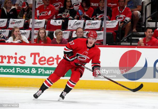 Andrei Svechnikov of the Carolina Hurricanes skates for position on the ice during an NHL game against the New York Islanders on October 4 2018 at...