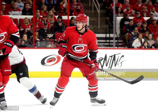 Andrei Svechnikov of the Carolina Hurricanes skates for position on the ice during an NHL game against the Colorado Avalanche on October 20 2018 at...