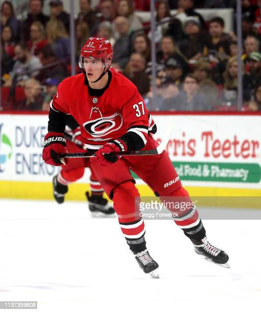Andrei Svechnikov of the Carolina Hurricanes skates for position on the ice during an NHL game against the Pittsburgh Penguins on March 19 2019 at...