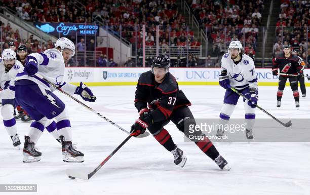 Andrei Svechnikov of the Carolina Hurricanes skates for position on the ice with the puck in Game Five of the Second Round of the 2021 Stanley Cup...