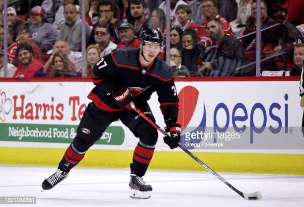 Andrei Svechnikov of the Carolina Hurricanes skates with the puck in Game One of the Second Round of the 2021 Stanley Cup Playoffs against the Tampa...