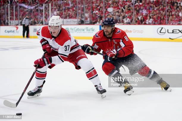 Andrei Svechnikov of the Carolina Hurricanes skates with the puck against Alex Ovechkin of the Washington Capitals in the third period in Game Two of...