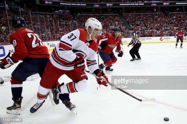 Andrei Svechnikov of the Carolina Hurricanes skates with the puck against the Washington Capitals in Game One of the Eastern Conference First Round...