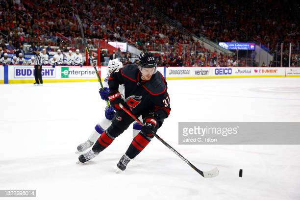 Andrei Svechnikov of the Carolina Hurricanes skates with the puck during the third period in Game Five of the Second Round of the 2021 Stanley Cup...