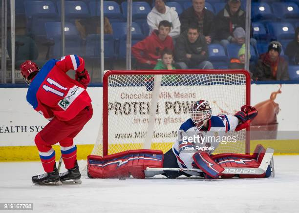 Andrei Svechnikov of the Russian Nationals controls the puck in front of Jack Hughes of the USA Nationals during the 2018 Under18 Five Nations...