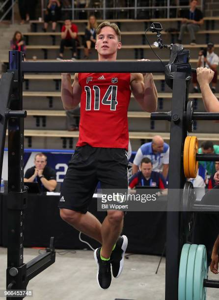 Andrei Svechnikov performs pullups during the NHL Scouting Combine on June 2 2018 at HarborCenter in Buffalo New York