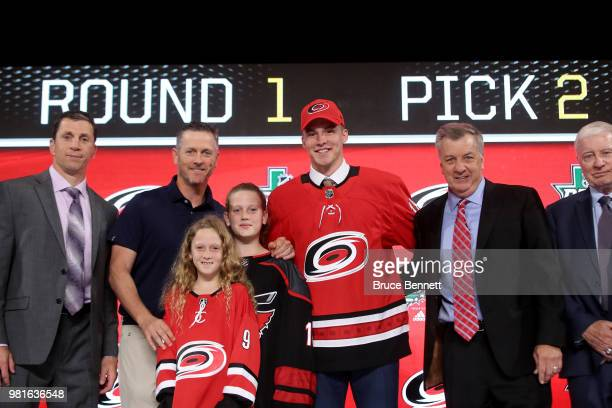 Andrei Svechnikov poses after being selected second overall by the Carolina Hurricanes during the first round of the 2018 NHL Draft at American...
