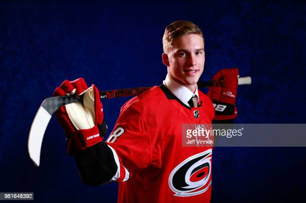 Andrei Svechnikov poses for a portrait after being selected second overall by the Carolina Hurricanes during the first round of the 2018 NHL Draft at...