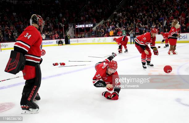 Andrei Svecnikov of the Carolina Hurricanes Petr Mrazek and Nino Niederreiter participate in the Storm Surge following a victory over the Winnipeg...