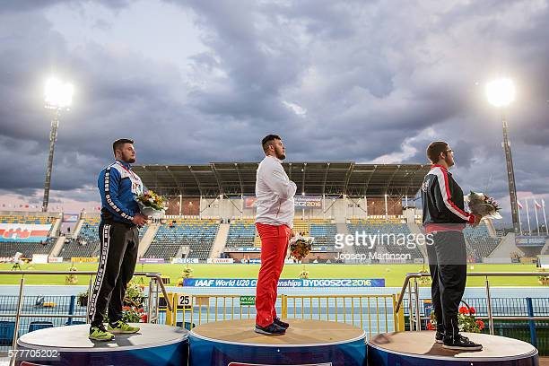 Andrei Toader from Romania Konrad Bukowiecki from Poland and Bronson Osborn from USA celebrate on the podium in men's shot put during the IAAF World...