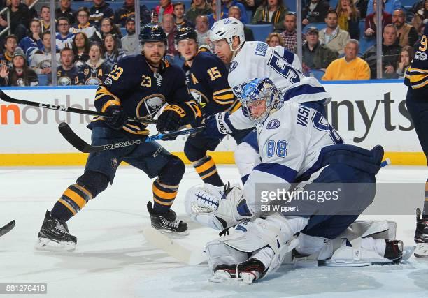 Andrei Vasilevskiy and Braydon Coburn of the Tampa Bay Lightning defends against Sam Reinhart of the Buffalo Sabres during an NHL game on November 28...
