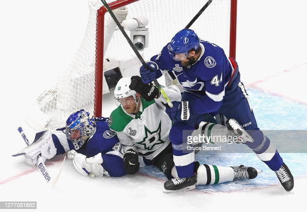 Andrei Vasilevskiy and Jan Rutta of the Tampa Bay Lightning defend against Corey Perry of the Dallas Stars and in Game Five of the 2020 NHL Stanley...