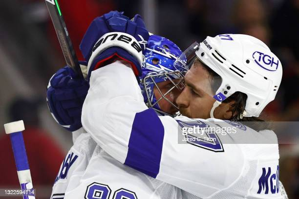 Andrei Vasilevskiy and Ryan McDonagh of the Tampa Bay Lightning react after defeating the Carolina Hurricanes in Game Five of the Second Round of the...