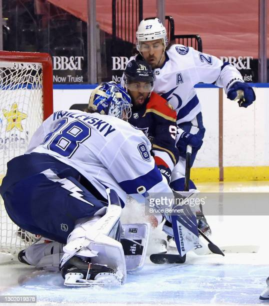 Andrei Vasilevskiy and Ryan McDonagh of the Tampa Bay Lightning defend the net against Anthony Duclair of the Florida Panthers during the second...