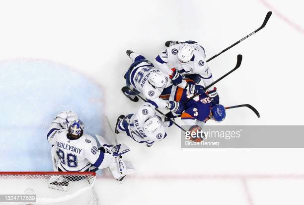 Andrei Vasilevskiy and the Tampa Bay Lightning defends against Jean-Gabriel Pageau of the New York Islanders in Game Four of the Stanley Cup...