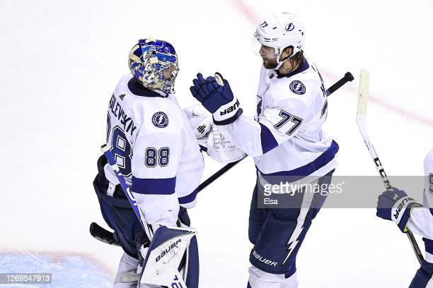 Andrei Vasilevskiy and Victor Hedman of the Tampa Bay Lightning celebrate their teams 3-1 victory against the Boston Bruins in Game Four of the...