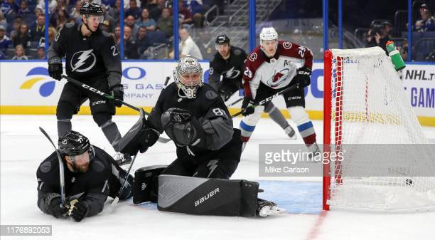 Andrei Vasilevskiy and Victor Hedman of the Tampa Bay Lightning looks back at a goal by the Colorado Avalanche during the third period at the Amalie...