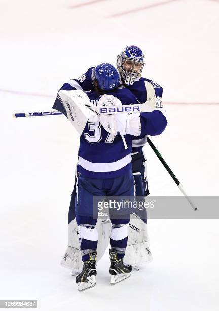 Andrei Vasilevskiy and Yanni Gourde of the Tampa Bay Lightning celebrate after the gamewinning goal by Victor Hedman during the second overtime...