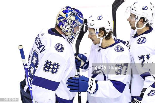 Andrei Vasilevskiy and Yanni Gourde of the Tampa Bay Lightning celebrate their teams 21 win against the Columbus Blue Jackets in Game Four of the...