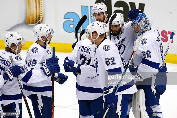 Andrei Vasilevskiy of the Tampa Bay Lightning celebrates with his teammates after defeating the Pittsburgh Penguins in Game One of the Eastern...
