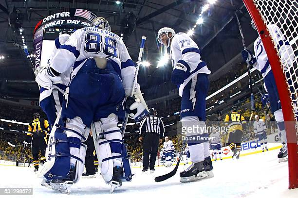 Andrei Vasilevskiy of the Tampa Bay Lightning celebrates with his teammate Victor Hedman after defeating the Pittsburgh Penguins in Game One of the...