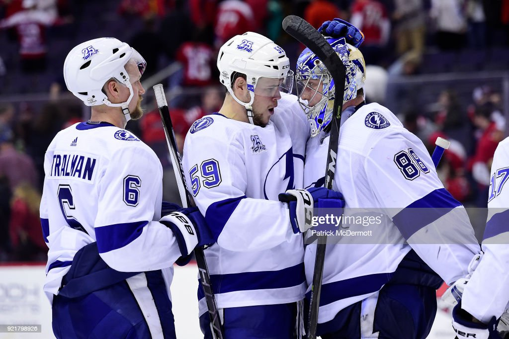 Andrei Vasilevskiy #88 of the Tampa Bay Lightning celebrates with his teammates Jake Dotchin #59 and Anton Stralman #6 after the Lightning defeated the Washington Capitals 4-2 at Capital One Arena on February 20, 2018 in Washington, DC.