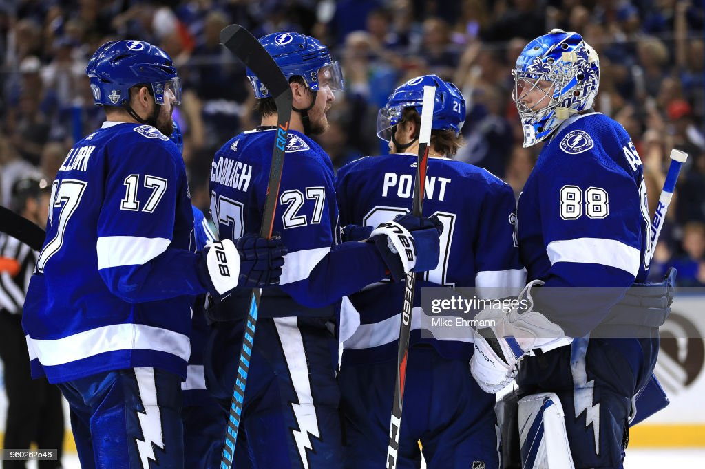 Andrei Vasilevskiy #88 of the Tampa Bay Lightning celebrates with his teammates Brayden Point #21, Ryan McDonagh #27 and Alex Killorn #17 after defeating the Washington Capitals in Game Five of the Eastern Conference Finals during the 2018 NHL Stanley Cup Playoffs at Amalie Arena on May 19, 2018 in Tampa, Florida. The Tampa Bay Lightning defeated the Washington Capitals with a score of 3 to 2.