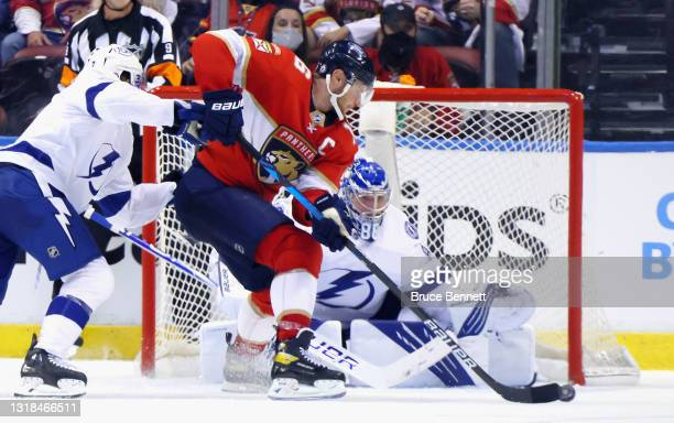 Andrei Vasilevskiy of the Tampa Bay Lightning defends against Aleksander Barkov of the Florida Panthers in Game One of the First Round of the 2021...