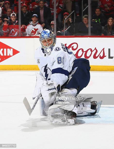 Andrei Vasilevskiy of the Tampa Bay Lightning defends his net against the New Jersey Devils in Game Four of the Eastern Conference First Round during...